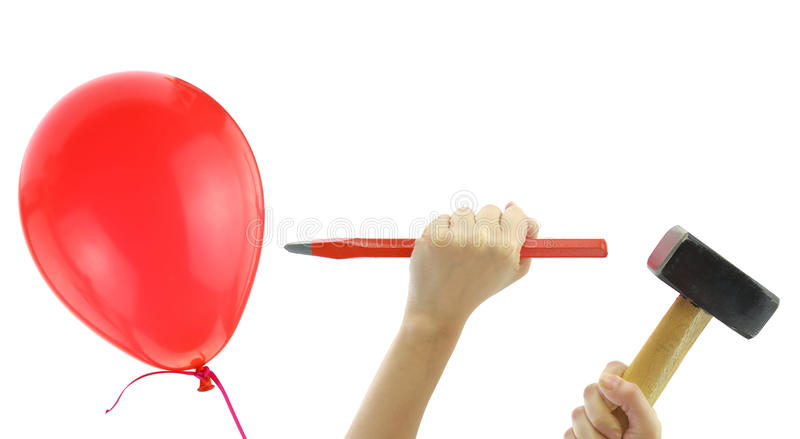 Chisel and hammer about to pop a balloon. Isolated on white royalty free stock photo