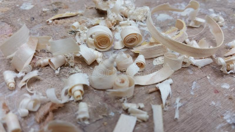 Chisel shavings and Leftovers. Wood shavings cover the benchtop after some work has been done to a piece of maple royalty free stock photos