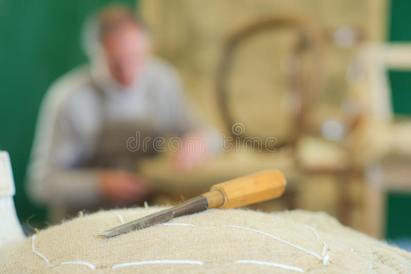 Chisel and worker on background royalty free stock photography