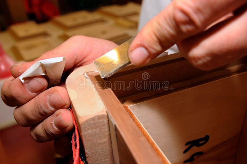 Chiseling wood in the carpentry. Manual work with a chisel royalty free stock photo