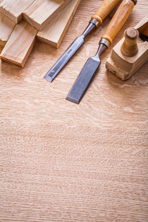 Chisels woodworkers plane and wooden planks on. Board construction concept royalty free stock image
