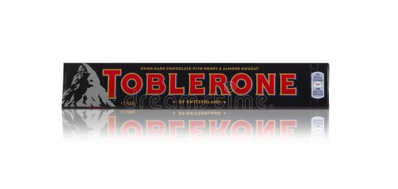 Toblerone - Swiss milk chocolate with honey and almond nougat on. CHISINAU, MOLDOVA - December 9, 2017: Toblerone - Swiss milk chocolate with honey and almond royalty free stock photos