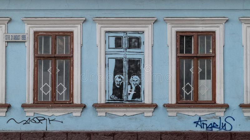 CHISINAU, MOLDOVA - 3 JANUARY, 2017: A graffiti in the center of Chisinau, on a abandoned building, making a reference to the elde royalty free stock photo