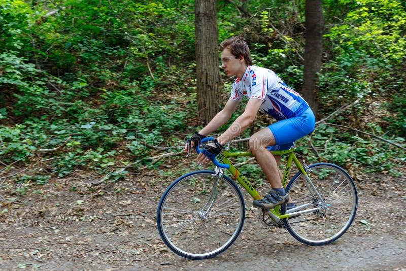 Chisinau, Republic of Moldova - July 16, 2017: cyclist at team Katusha rides a bicycle along a forest road. stock photo