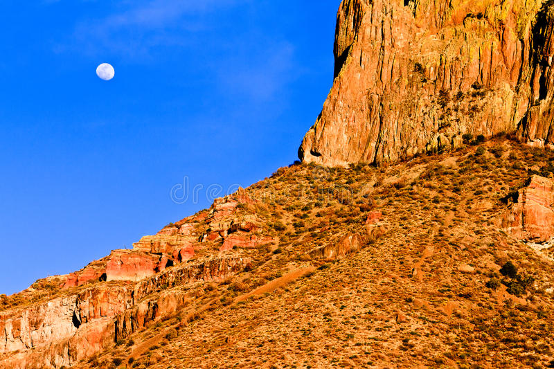 Chisos Mountain. A Chisos mountain in Big Bend National Park with moon and sunset light shining on it royalty free stock photography
