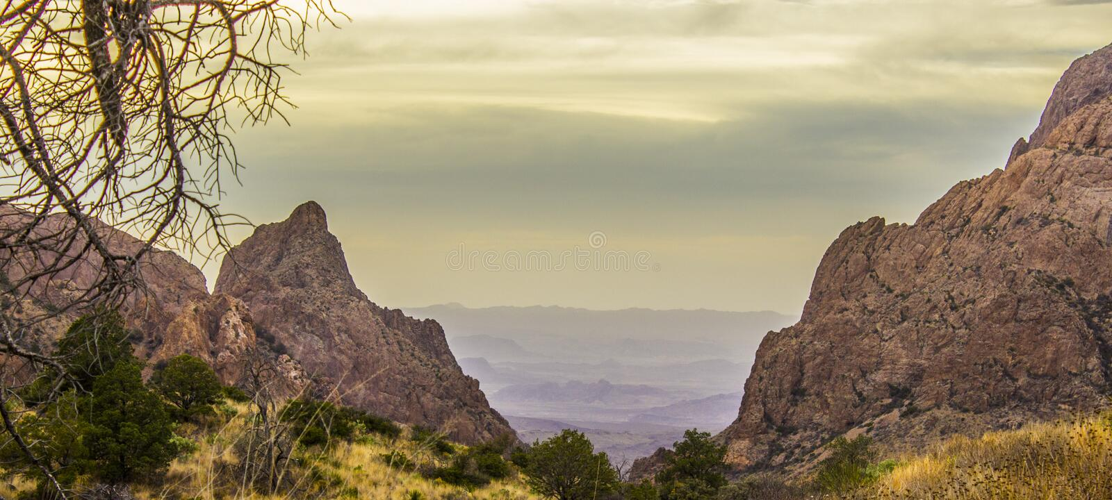 Chisos Mountain Window with Mordor. A colorful desert meadow with the bright Chisos Mountains surrounding it with a bland, evil looking desert beyond. Big Bend stock photography