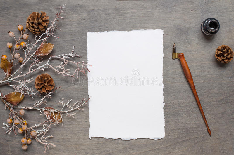 Chistmas background. With handmade paper, cone, ink and pen oblique holder. Top view stock images