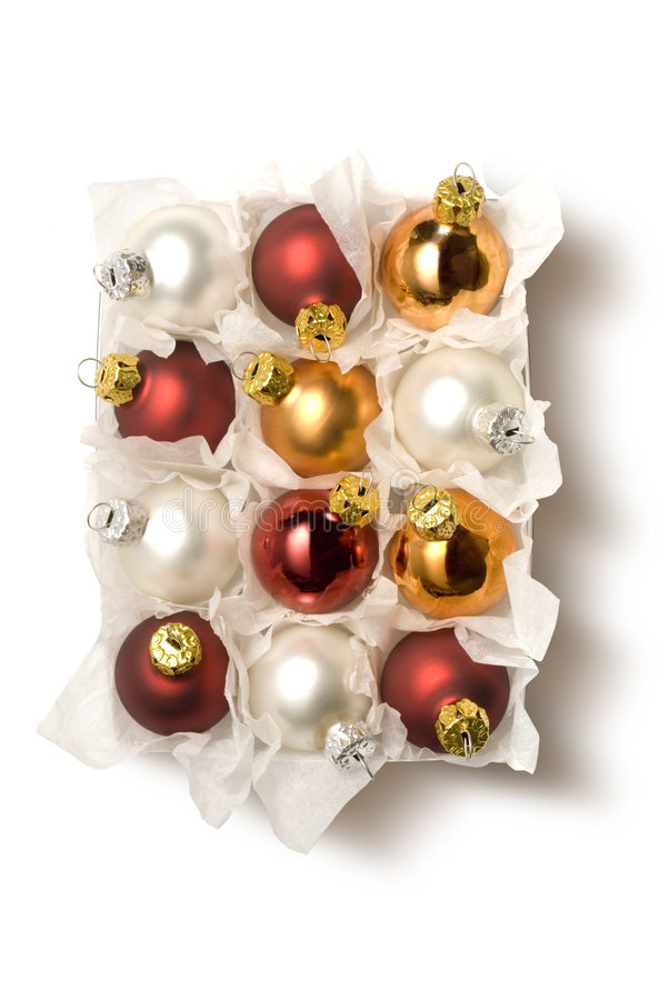 Chistmas balls in box. Box of colored chistmas balls isolated royalty free stock photography