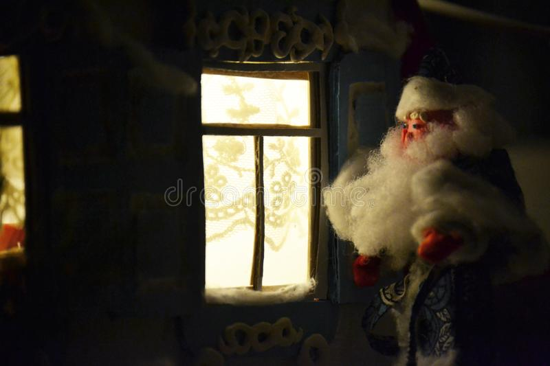 Chistmas photo with Father Frost and holiday`s windows stock photography