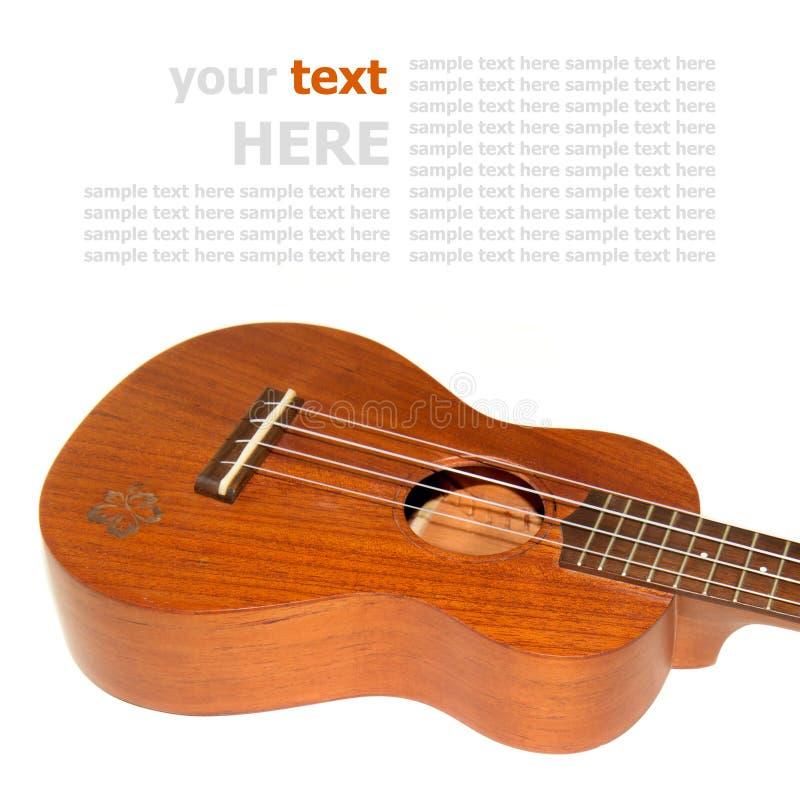 Chitarra delle ukulele isolata su fondo bianco fotografia stock libera da diritti