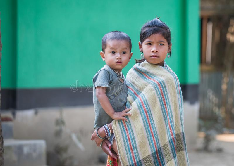 Young lady with a baby in a countryside of Bangladesh royalty free stock images