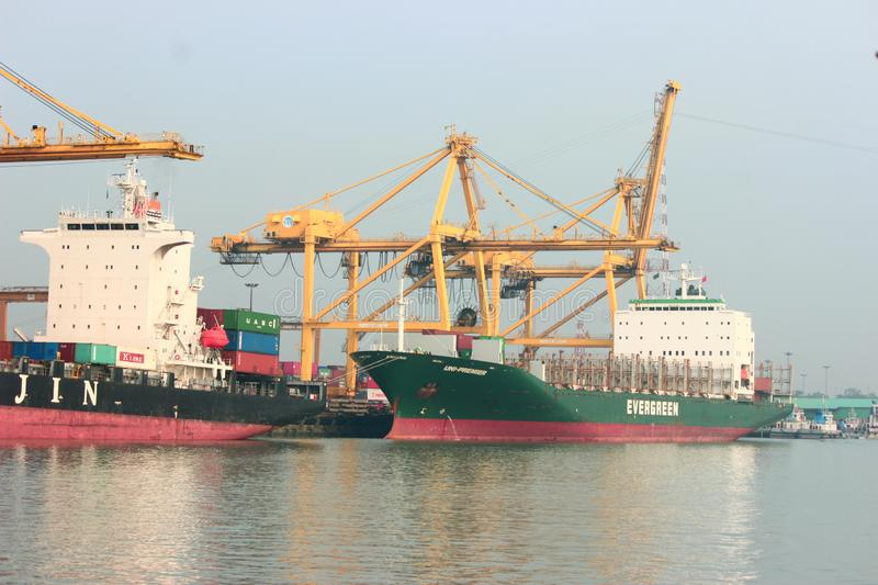 At Chittagong port, cargo ships stand on the Karnaphuli river stock photo