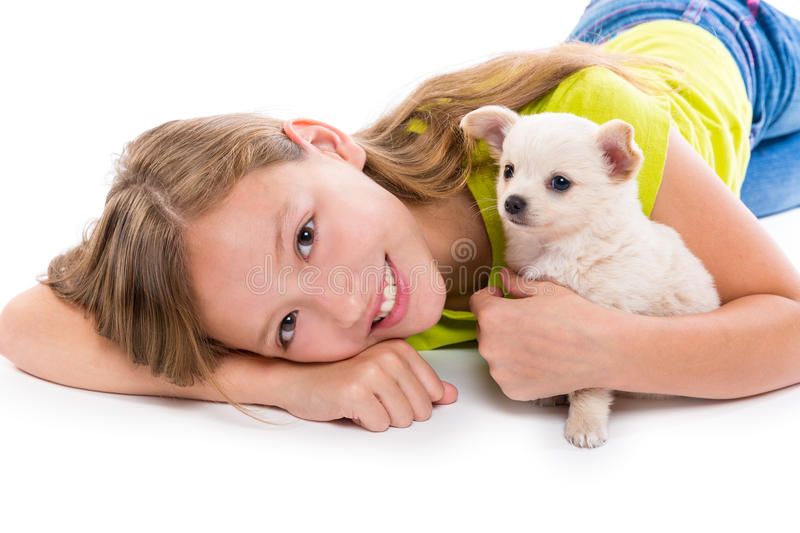 Chiuahua puppy dog and kid girl happy together royalty free stock photography
