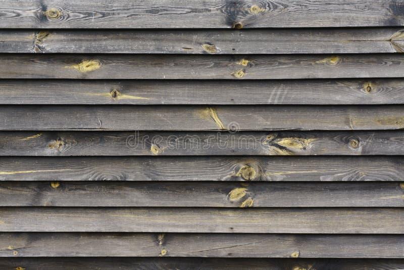 Chiuda in su dei comitati di legno grigi della rete fissa fotografia stock libera da diritti