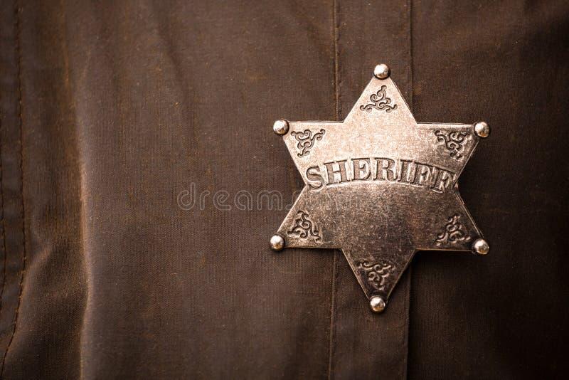 Chiuda su del distintivo dello sceriffo immagini stock libere da diritti