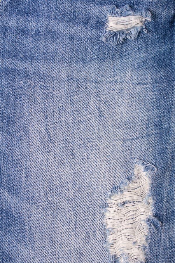 Chiuda su del fondo del denim delle blue jeans immagine stock