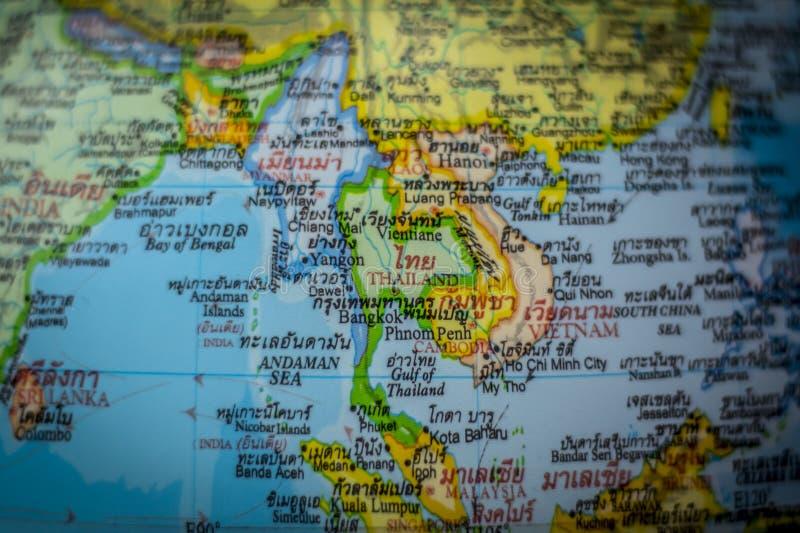 Chiuda su del paese della Tailandia su una mappa di mondo fotografie stock