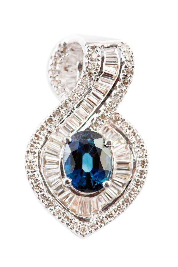 Chiuda in su del pendente o dell'orecchino del diamante fotografia stock libera da diritti