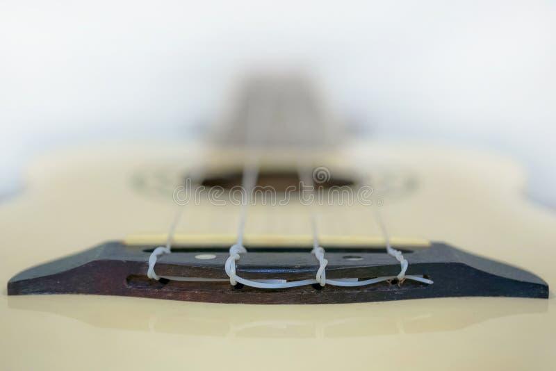 Chiuda su del ponte delle ukulele nella profondità di campo molto bassa immagini stock libere da diritti