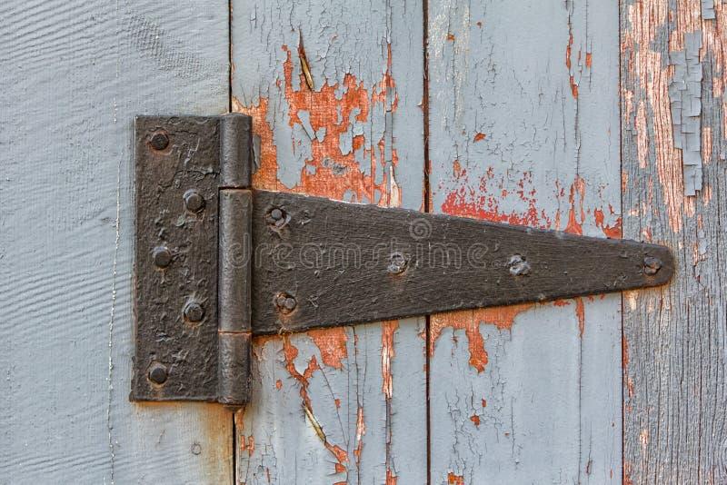 Chiuda in su della cerniera antica del granaio fotografia stock libera da diritti