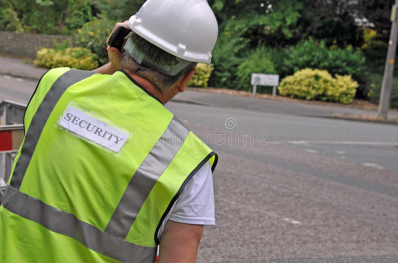 Chiuda su della guardia giurata di sicurezza immagini stock