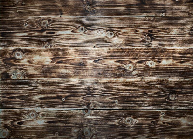Chiuda su della parete fatta delle plance di legno fotografie stock