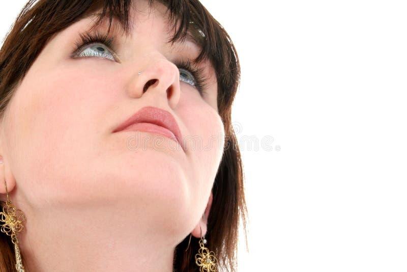 Chiuda in su della ragazza teenager che osserva in su fotografia stock