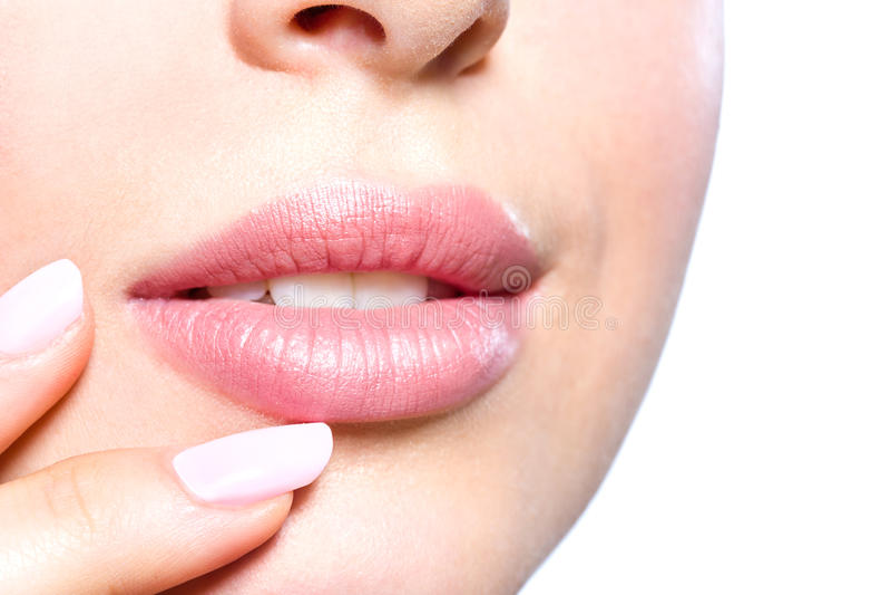 Chiuda su delle labbra femminili fotografia stock libera da diritti