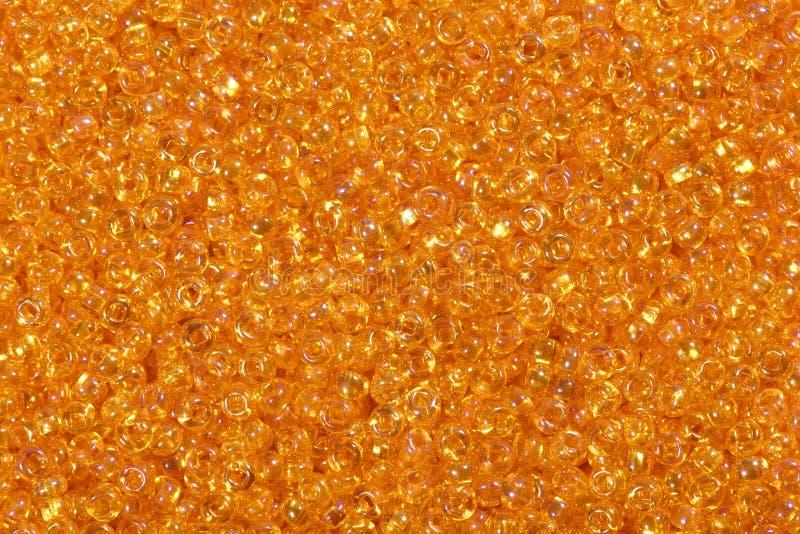 Chiuda su delle perle arancio luminose del seme fotografia stock libera da diritti
