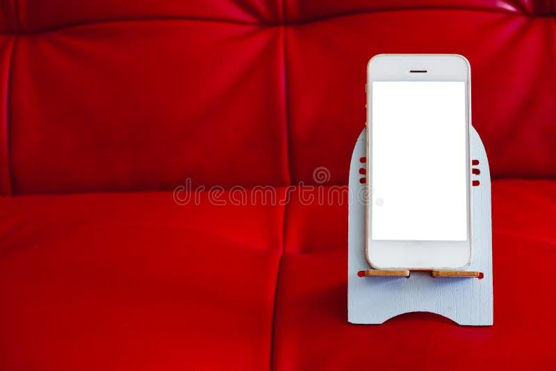 Chiuda su dello smartphone con lo schermo bianco immagine stock libera da diritti