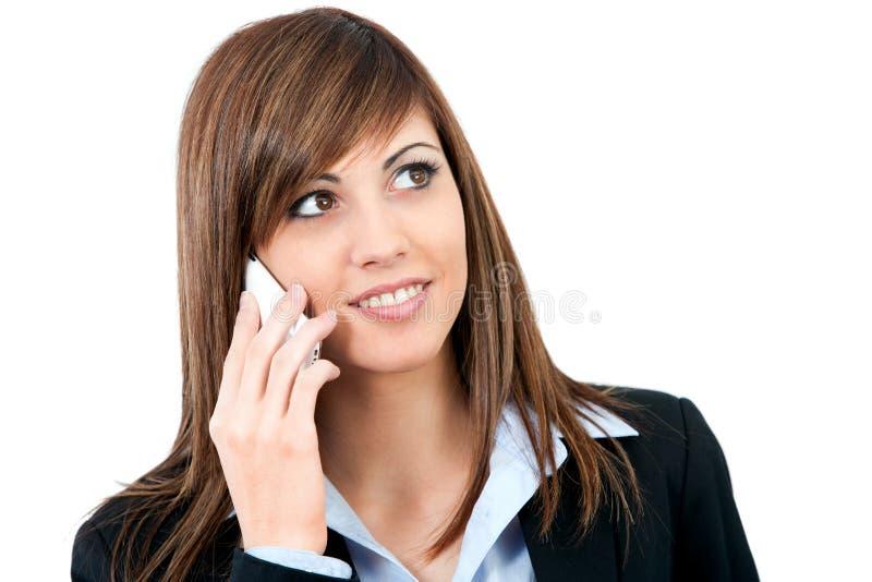 Chiuda in su di giovane donna che comunica sul telefono delle cellule. immagine stock libera da diritti