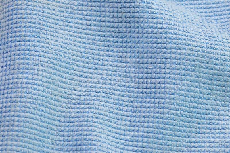 Chiuda su di struttura blu del tessuto del microfiber dell'onda con copia-spazio fotografia stock libera da diritti