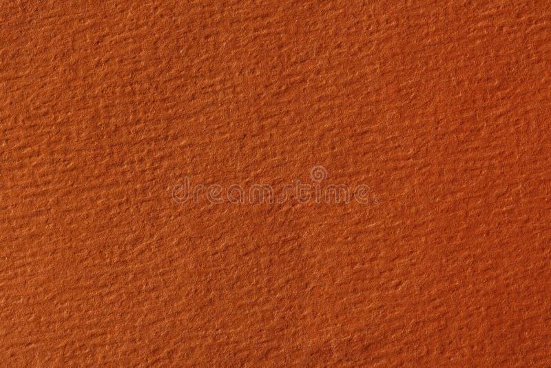 Chiuda su di struttura di carta arancione, fondo immagini stock libere da diritti