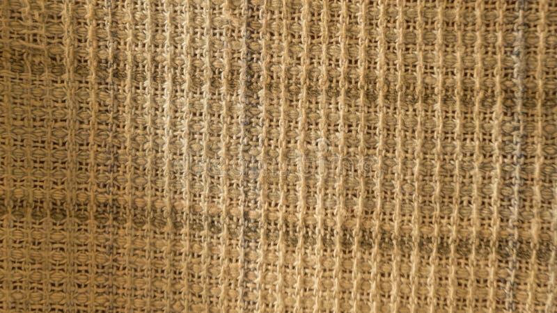 Chiuda su di struttura sgualcita del tessuto, fondo del tessuto del panno di tela di tessuto leggero con l'onda incrociata Modell immagine stock