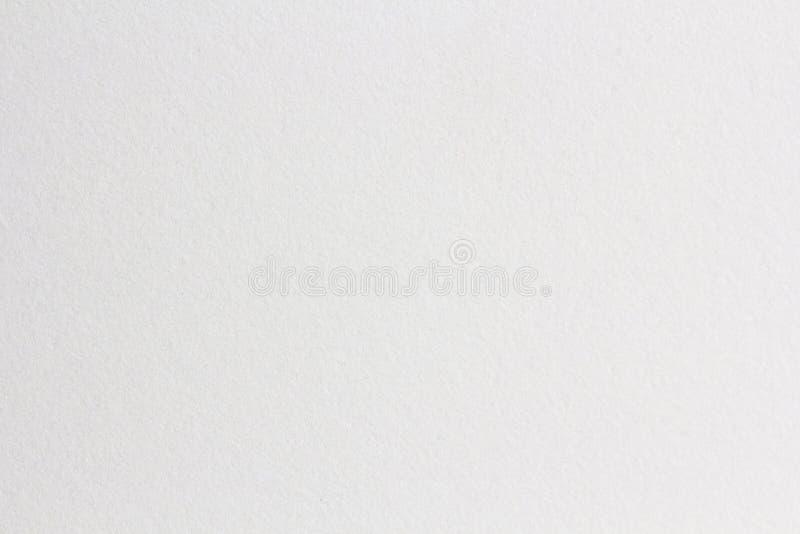 chiuda su di un fondo di carta strutturato bianco fotografia stock