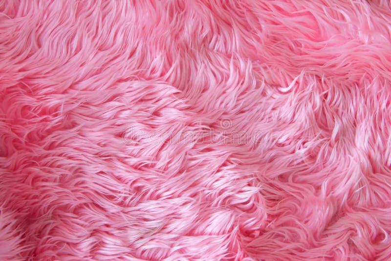 Chiuda su struttura rosa o sul tappeto della pelliccia per fondo fotografia stock libera da diritti