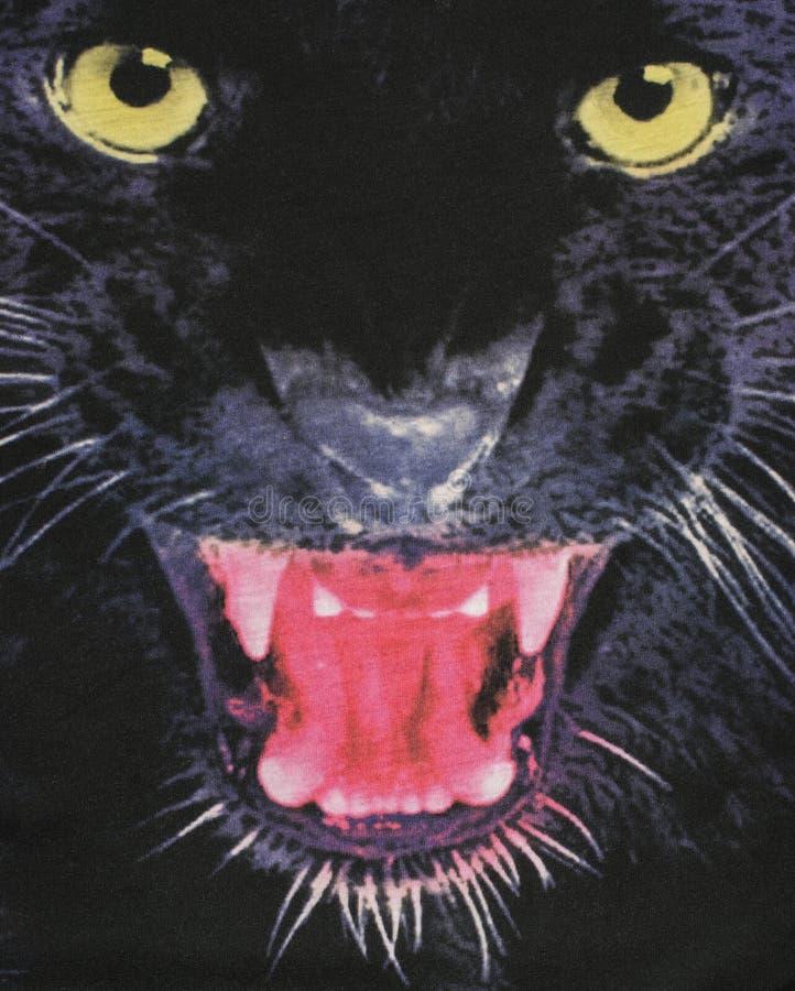 Chiuda su sulla testa di una pantera nera su tessuto fotografia stock libera da diritti