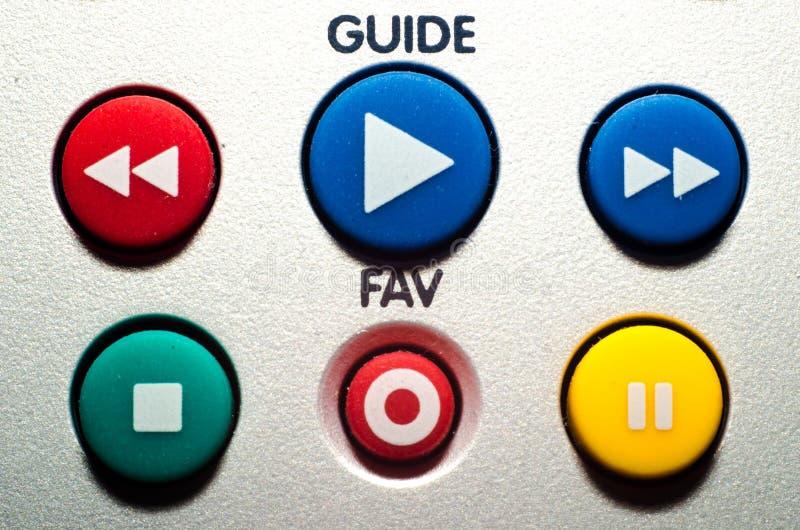 Chiuda sui bottoni variopinti a distanza della TV immagini stock