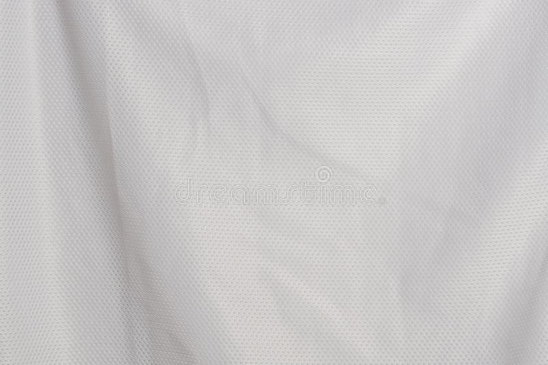 Chiuda sui precedenti bianchi del materiale di struttura di sport del jersey del tessuto immagine stock libera da diritti