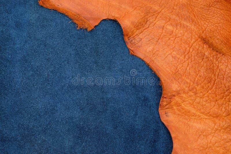 Chiuda sul disaccordo arancio del cuoio dei blu navy e del bordo approssimativo in due s fotografia stock