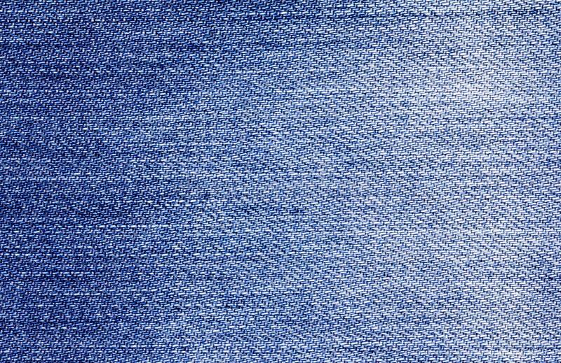 Chiuda sul fondo di superficie di struttura delle blue jeans del denim fotografia stock