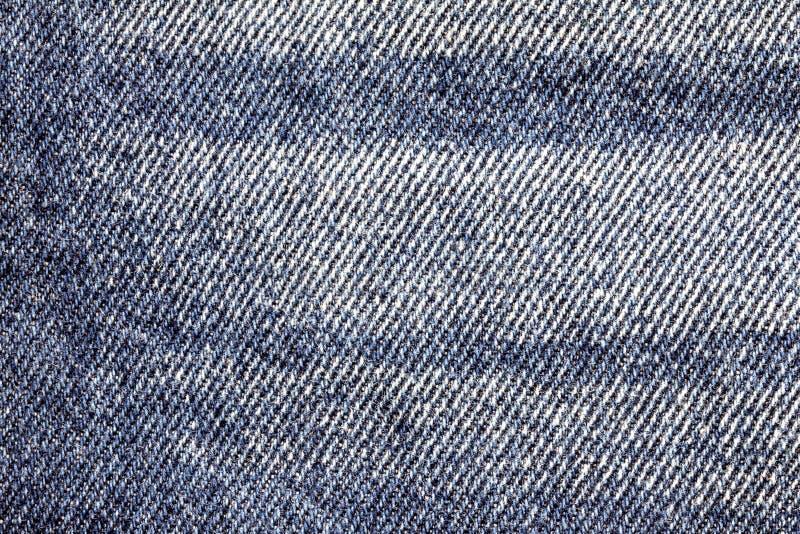 Chiuda sul fondo di superficie di struttura delle blue jeans del denim immagini stock libere da diritti