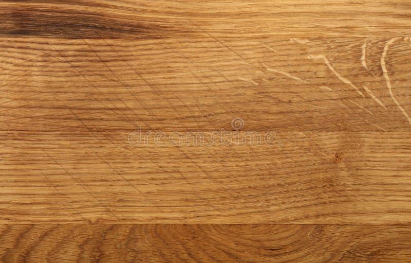 Chiuda sul fondo scuro di struttura del bordo di legno di quercia immagini stock