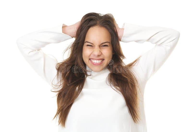 Chiuda sul ritratto di un sorridere della giovane donna fotografia stock