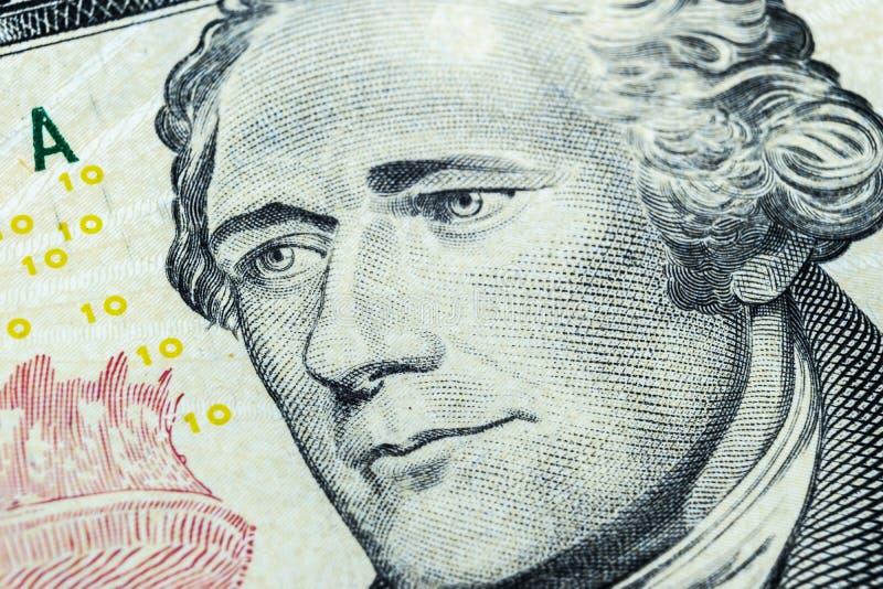 Chiuda sul ritratto di vista di Alexander Hamilton sull'una banconota in dollari dieci Fondo dei soldi banconota in dollari 10 co immagine stock