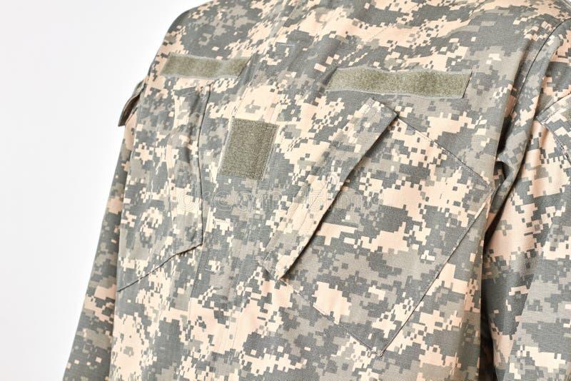 Chiuda sull'uniforme militare dell'esercito della giungla immagini stock