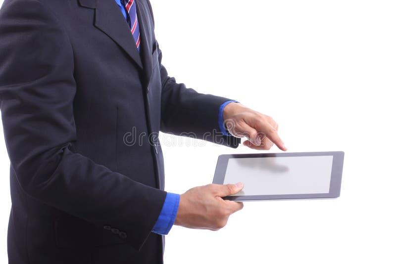 Chiuda sull'uomo d'affari il cuscinetto di tocco che di uso include il percorso di ritaglio immagini stock