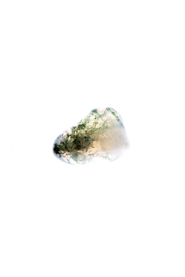 Chiuda sulla gemma o sul cristallo verde e gialla isolato con il BAC bianco immagine stock libera da diritti