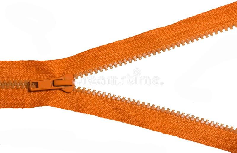 Chiusura lampo arancio su fondo bianco fotografia stock