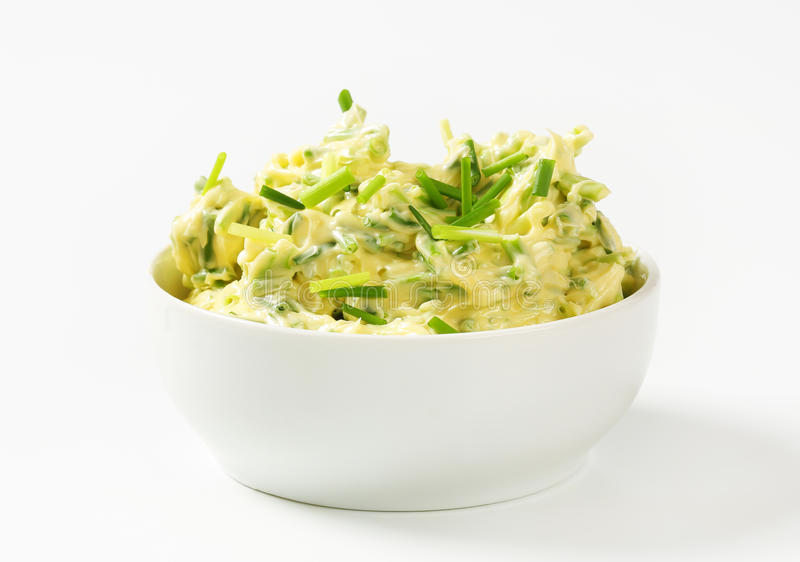 Chive butter. Bowl of homemade chive butter royalty free stock image